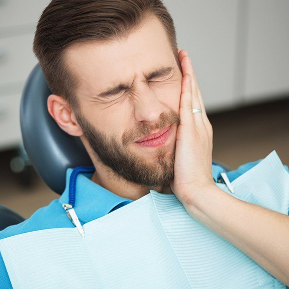 Man in pain at dental office for emergency dentistry