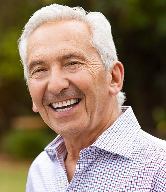 Older man sharing healthy smile after periodontal therapy