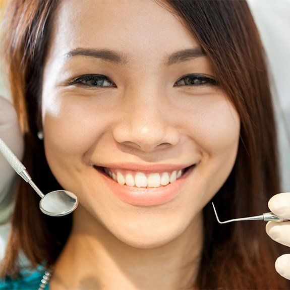 Woman smiling during preventive dentistry appointment