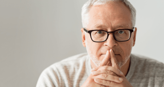 Older man considering periodontal therapy option