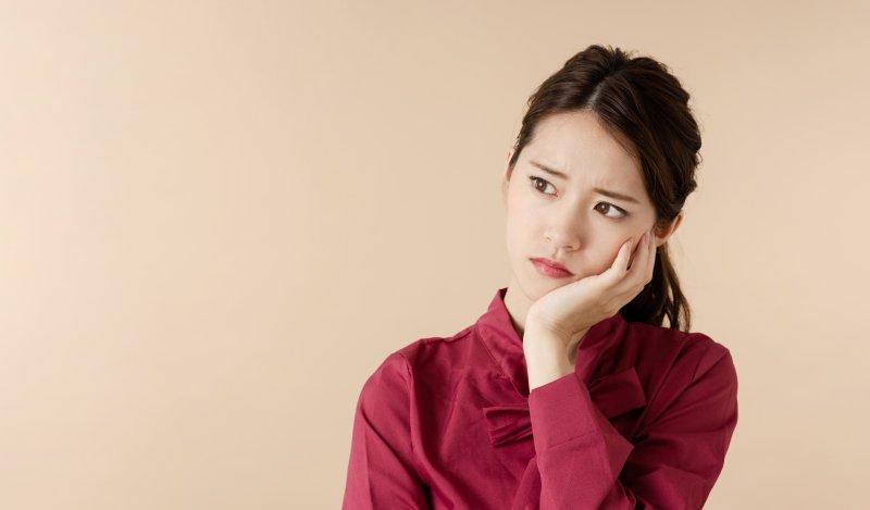 Woman experiencing enamel wear